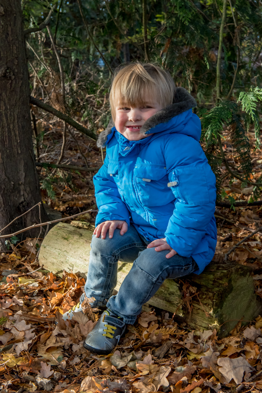 Eldest son sitting on log